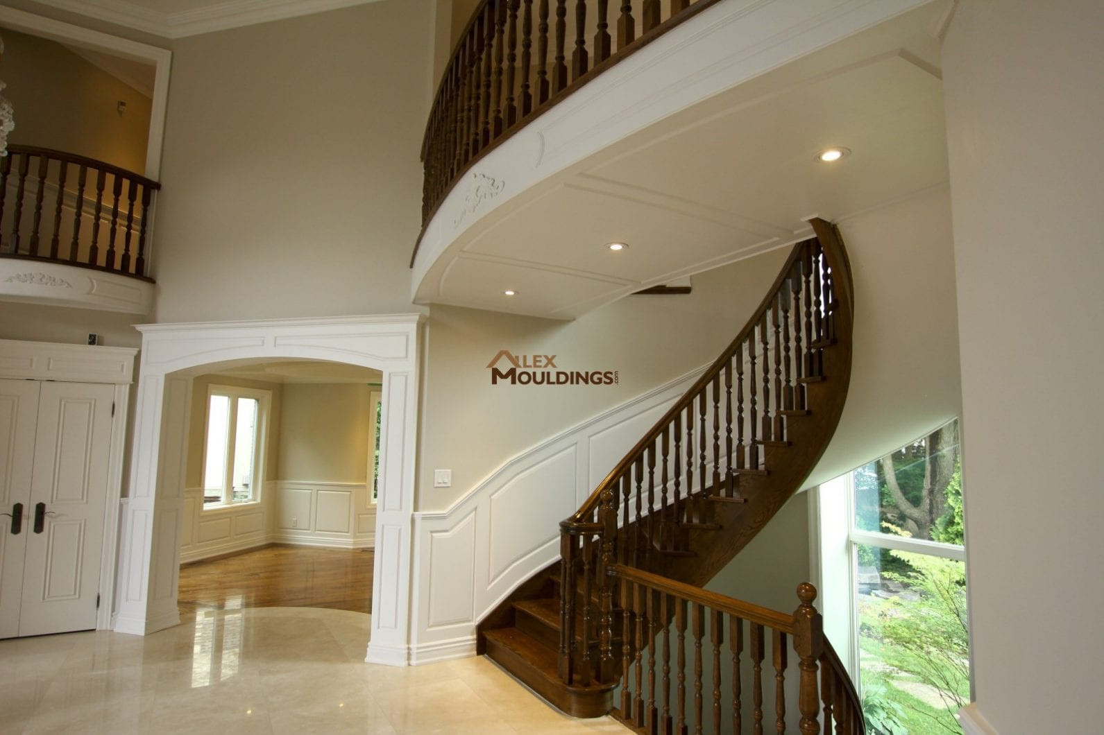 Curved stairs wainscoting